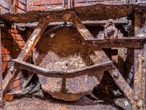 Old rusty metal mechanism. In the brick wall royalty free stock photography