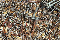 Old rusty metal nails bolts nuts and screws as background Royalty Free Stock Photos