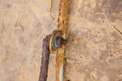 Old rusty metal nut on iron water valve Royalty Free Stock Photo