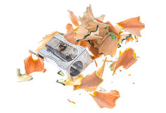 Old rusty metal pencil sharpener and different colour shavings. Stock Image