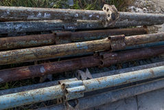 Old rusty metal pipes pile Stock Image