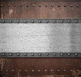 Old rusty metal plate background with rivets Royalty Free Stock Image