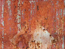Old rusty metal plate with cracked paint. Stock Image