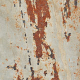 Old rusty metal plate with gray paint Royalty Free Stock Photo