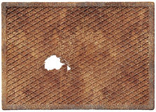 Old rusty metal plate with a hole Stock Photo