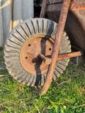 Old rusty metal and rubber wheel of hand-barrow Stock Photo