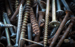 Old rusty metal screws Stock Photo