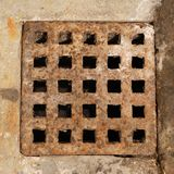 Old and rusty metal sewer lid Stock Photos