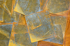 Old rusty metal sheets background. In orange tone Stock Photos