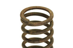 Old rusty metal spring. On a white background Royalty Free Stock Images