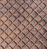 Old rusty metal street sewer drain cover top hatch texture. Close up of steel cover made of squares. Dimension 1x1 cm Stock Images