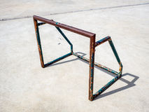 Old and rusty mini soccer football goal on concrete floor. In the afternoon Royalty Free Stock Photo