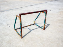 Old and rusty mini soccer football goal on concrete floor in the. Afternoon Stock Images