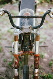 Old and rusty Motorbike parked on the sand Royalty Free Stock Images