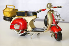 Old Rusty Motorcycle Toy. Colorful old rusty motorcycle metal toy Royalty Free Stock Photos