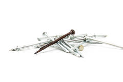 Old rusty nail and new ones Royalty Free Stock Images