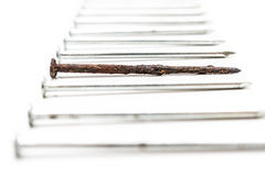 Old rusty nail and new ones Royalty Free Stock Image