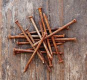 Old rusty nails. On wooden background Royalty Free Stock Image