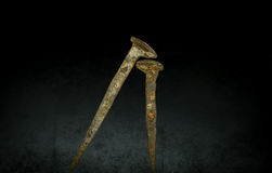 Old rusty nails on black background. Old large rusty nails on black background Stock Photo
