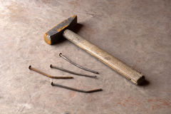 Old rusty nails and hammer. On a wooden background Royalty Free Stock Photography