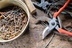 Old rusty nails and screws in a bucket Royalty Free Stock Image