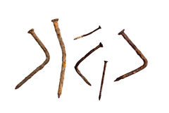 Old rusty nails. On white with natural shadows Royalty Free Stock Images