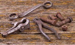 Old rusty nuts, bolts. Ancient tools. boards stock photos