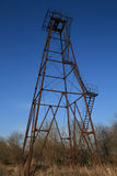 The old rusty oil derrick. The thrown old rusty oil derrick Stock Photography