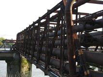 Old rusty oil pipes bridge Stock Photography
