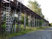Old rusty oil pipes bridge. Old oil pipes bridge used to pump the oil from ship to refinery Stock Images