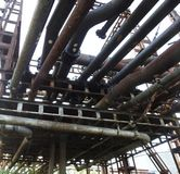 Old rusty oil pipes Royalty Free Stock Photography