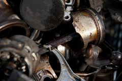 Old pistons from engine on scrap yard royalty free stock photo