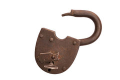 Old rusty opened padlock isolated on white background, key in the lock. Royalty Free Stock Photos