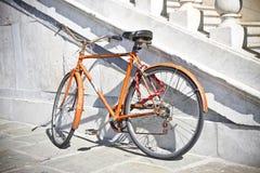 Old rusty orange bicycle Royalty Free Stock Image