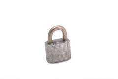 Old Rusty Padlock. A closeup of an old rusty padlock isolated on a white background Stock Photos