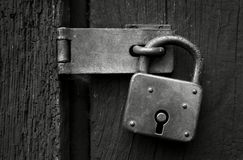 Old rusty padlock in black and white Royalty Free Stock Photos