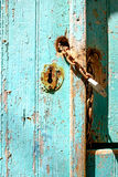Old rusty padlock and chain on weathered textured door Royalty Free Stock Image