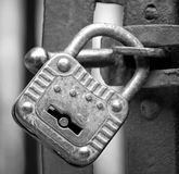 Old rusty padlock that closes the scratch of an ancient prison o Royalty Free Stock Image