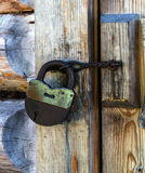 Old rusty padlock. Padlock with hasp on the old door Royalty Free Stock Image