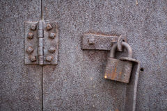 Old rusty padlock and hinge. Stock Photos