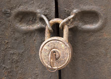 Old rusty padlock on a  iron door closeup Stock Images