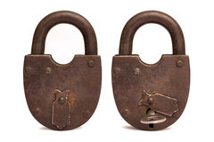 Old rusty padlock isolated on white background, key in the lock. Stock Images