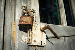 Old rusty padlock and latch Stock Images