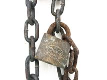 Old rusty padlock and metal chain link on white. Metal chain link on white background Royalty Free Stock Photography