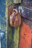 Old rusty padlock. And weathered door Stock Image