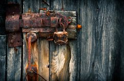 Old rusty padlock. On wooden door royalty free stock photos