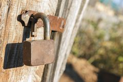 Old rusty padlock of an old wooden shed Royalty Free Stock Photography