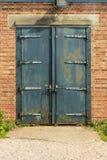 Old rusty padlocked blue metal door Royalty Free Stock Images