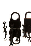 Old rusty padlocks and keys on white background. Mirror.  Royalty Free Stock Images