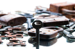 Old rusty padlocks and keys on white background. Mirror.  Royalty Free Stock Photo